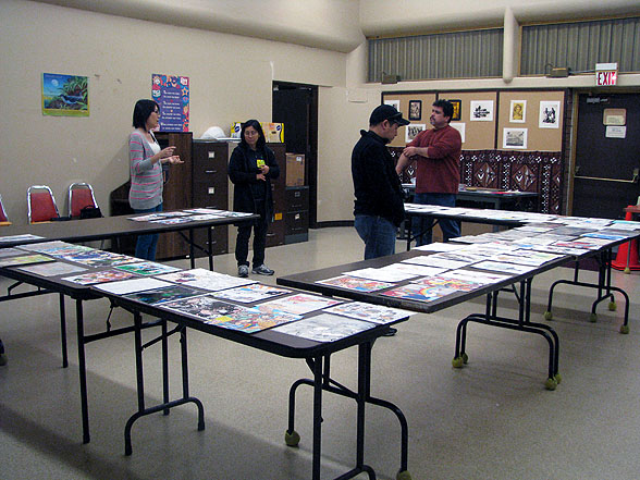 This is what 55 entries looks like. This is also what Audra, left, Linda, Audra's husband Scott Yoshinaga, and Roy look like looking at 55 entries.