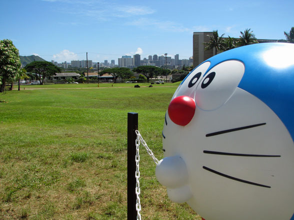 A Doraemon statue with the Honolulu skyline in the background. Pretty cool, really.
