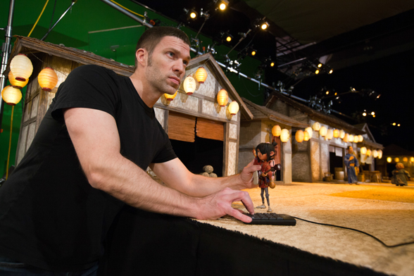 """Kubo and the Two Strings"" director Travis Knight works with Kubo on the ""Kubo's Village"" set. Courtesy Laika Studios/Focus Features."
